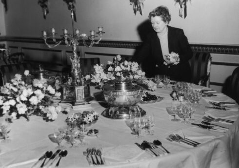 British floral artist Constance Spry (1886 - 1960) decorates the Queen's table at Lancaster House, London, ready for the Coronation Banquet being held there by the Foreign Office in honour of Queen Elizabeth II, 5th June 1953. (Photo by Ron Case/Keystone/Hulton Archive/Getty Images)