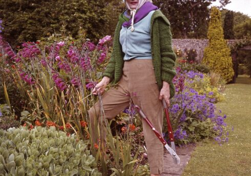 Portrait of Rhoda, Lady Birley (1900-1981) photographed by Valerie Finnis (1924-2006). Married to society painter Oswald Birley, Rhoda maintained the gardens of Charleston Manor Sussex and in 1935 set up a summer festival in the grounds, which continues to this day.