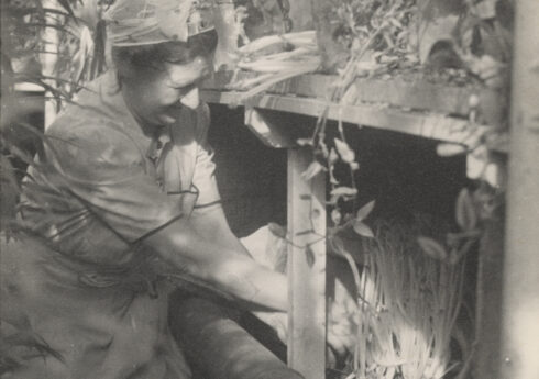 Constance Spry working in her greenhouse, c.1942, photographer unknown / RHS Lindley Collections