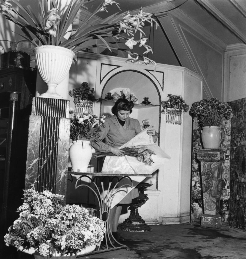 British floral expert Constance Spry (1886 - 1960) wraps a bouquet in her flower shop, June 1947. (Photo by George Konig/Keystone Features/Hulton Archive/Getty Images)