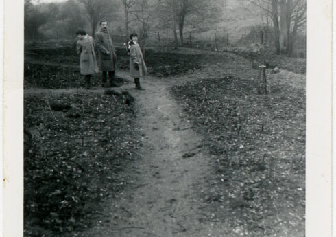 Andrew Chatto and his daughters at the site of White Barn House, 1959, when the paths and beds of the garden had only just been set out.